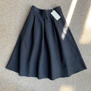 NWT. COS gray wool skirt with pockets and raw hem.